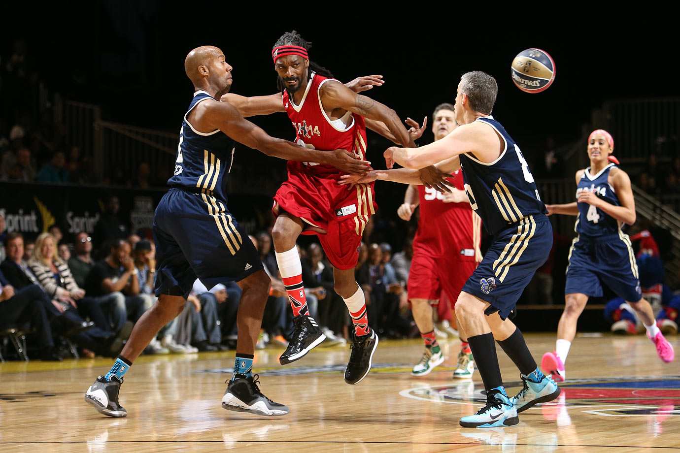 Snoop Dogg of the West Team passes against NBA Legend Bruce Bowen of the East Team during the Sprint NBA All-Star Celebrity Game on Feb. 14, 2014 at Sprint Arena in New Orleans.