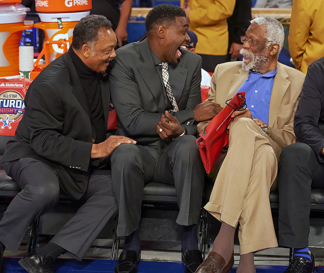 Reverend Jesse Jackson, NBA TV analyst Chris Webber and Bill Russell share a laugh during NBA All-Star Weekend in New Orleans.