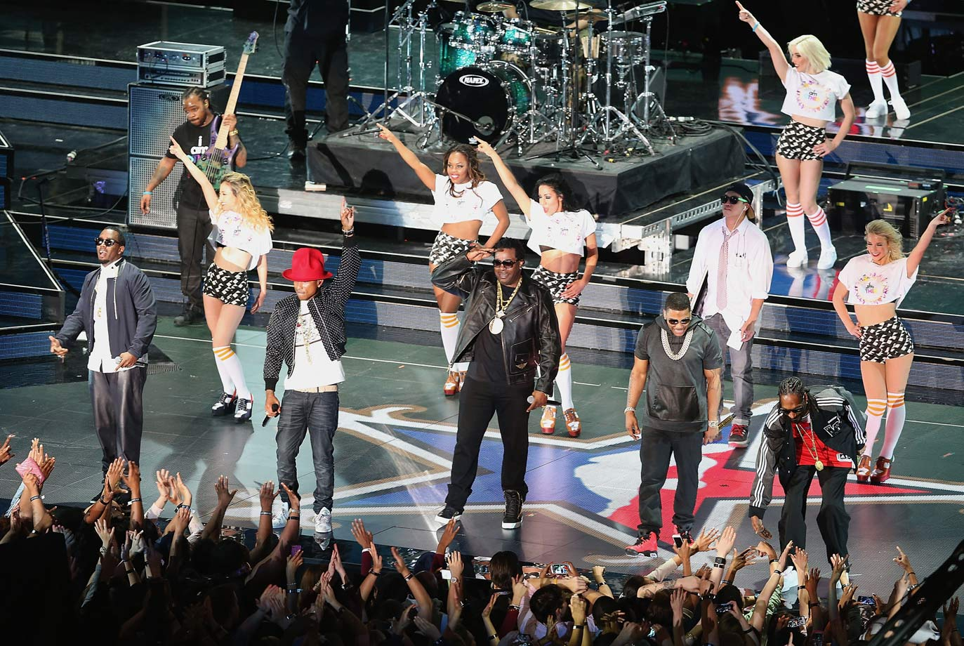 Sean Combs, Pharrell Williams, Busta Rhymes, Nelly and Snoop Dogg perform before the NBA All-Star game on Feb. 16, 2014 at the Smoothie King Center in New Orleans.