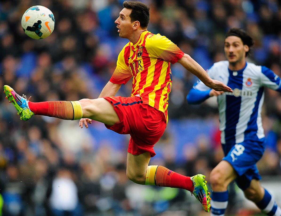 Barcelona's Lionel Messi plays the ball during their La Liga match against Espanyol on March 29, 2014 at Cornella-El Prat stadium in Cornella de Llobregat, Spain.