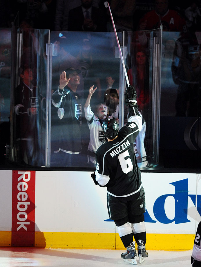 Will Ferrell watches Kings defenseman Jake Muzzin give his stick to Ferrell's son Magnus after Game Four of the Western Conference Final between the Los Angeles Kings and Chicago Blackhawks on May 26, 2014 at Staples Center in Los Angeles.