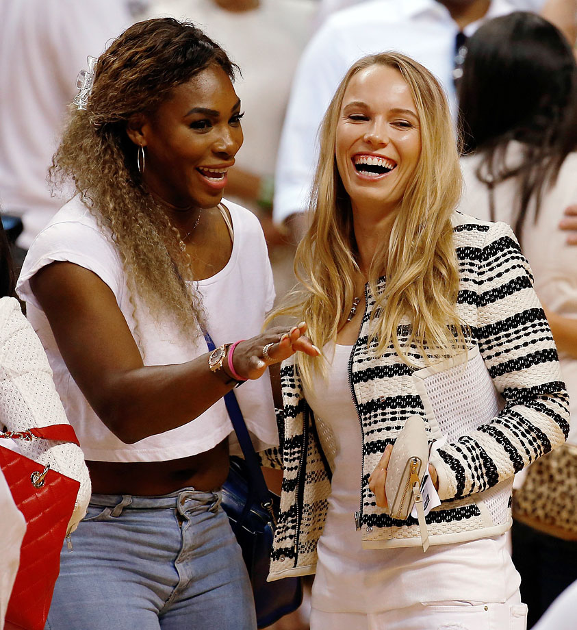 Serena Williams and Caroline Wozniacki stand on the court after the Miami Heat defeated the Indiana Pacers in Game Six of the Eastern Conference Finals on May 30, 2014 at American Airlines Arena in Miami.