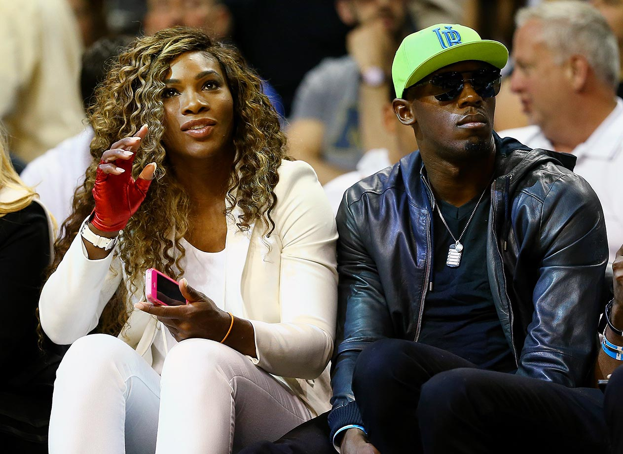 Usain Bolt sits alongside Serena Williams during Game 4 of the 2014 NBA Finals between the Miami Heat and San Antonio Spurs at American Airlines Arena in Miami.