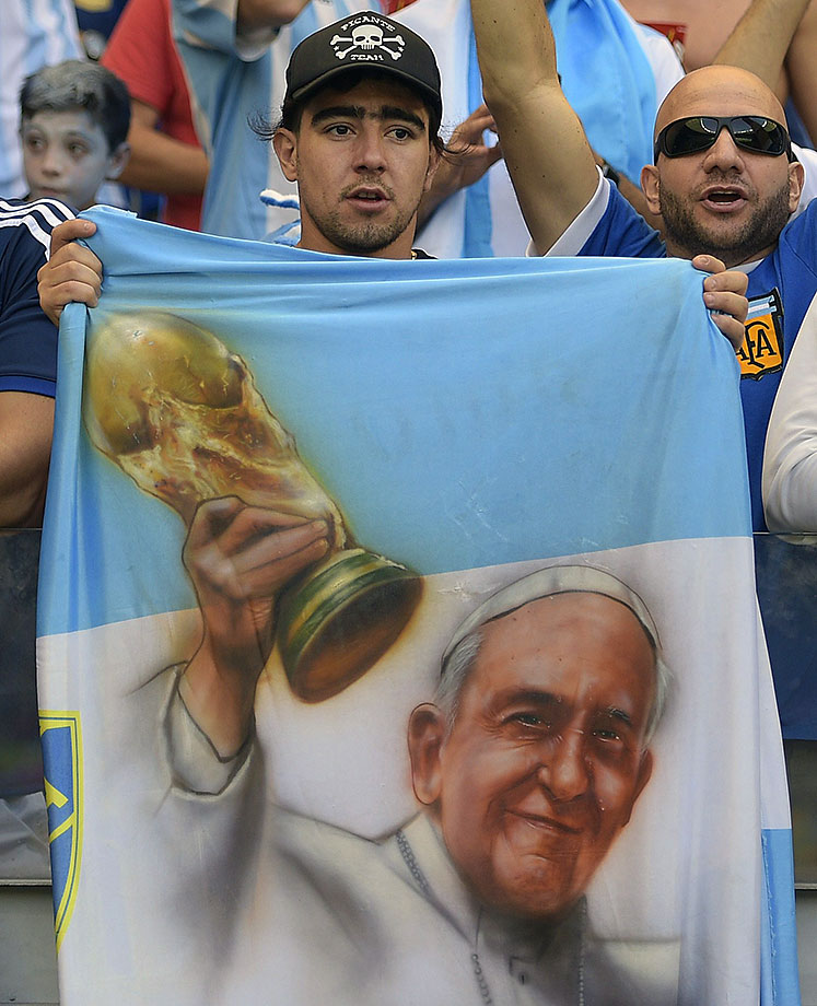 An Argentina fan holds a flag with a portrait of Pope Francis prior to a Group F football match between Argentina and Iran at the Mineirao Stadium in Belo Horizonte during the 2014 FIFA World Cup in Brazil on June 21, 2014.