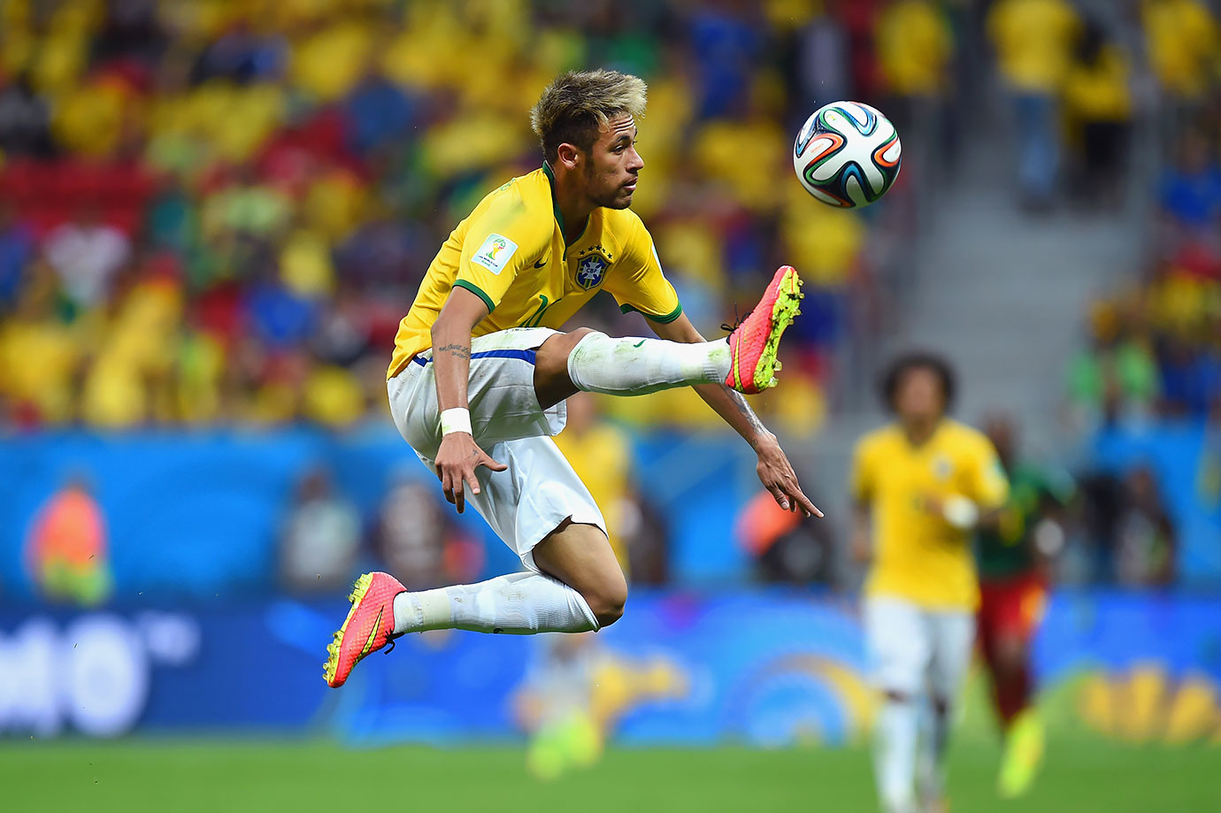 Neymar plays the ball during Brazil's World Cup match against Cameroon on June 23, 2014 at Estadio Nacional in Brasilia, Brazil.