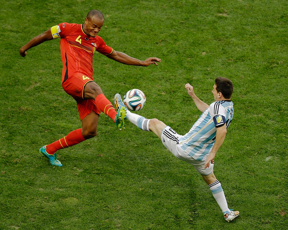 Belgium's Vincent Kompany and Argentina's Lionel Messi fight for the ball during the FIFA World Cup quarterfinal match on July 5, 2014 at the Estadio Nacional in Brasilia, Brazil.