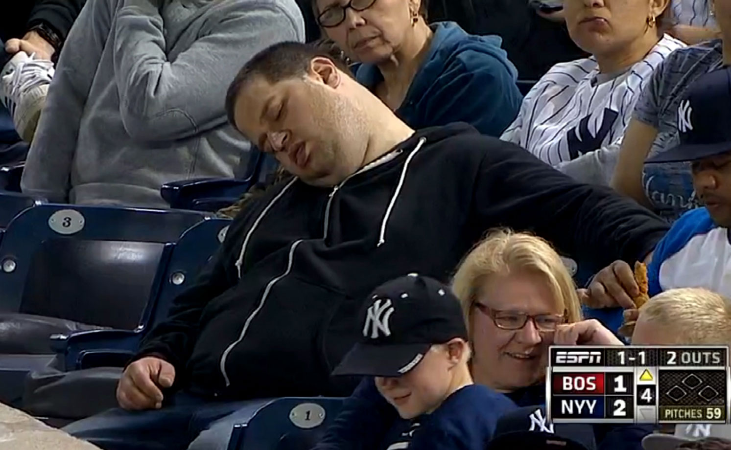 A man shown sleeping at an April 13 Yankees-Red Sox game has brought a $10 million suit against MLB, ESPN and the Yankees for defamation and emotional stress.