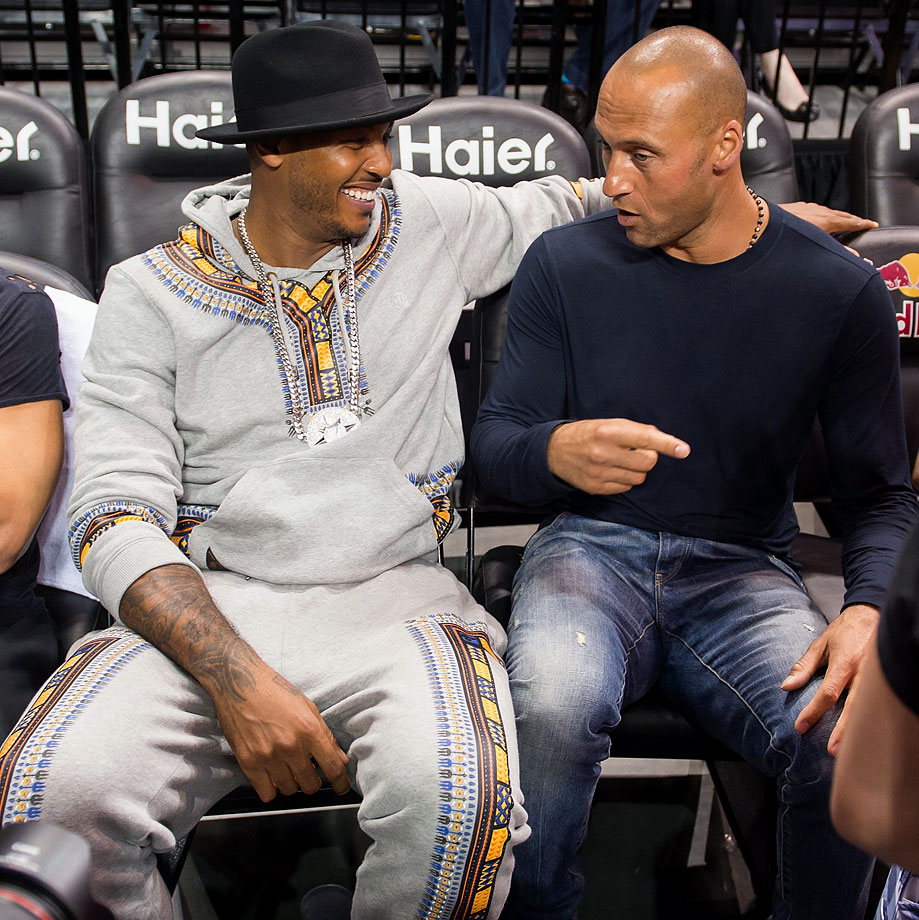 Carmelo Anthony and Derek Jeter attend the 2014 Summer Classic Charity Basketball Game at Barclays Center in New York City.