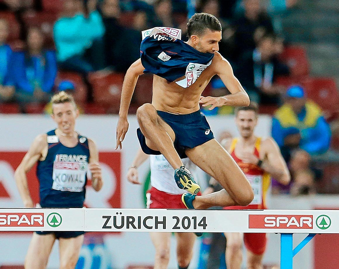 Mahiedine Mekhissi-Benabbad of France was disqualified after finishing first in the 3,000-meter steeplechase at the European Championships because he took off his shirt and put it in his mouth as he neared the finish line.