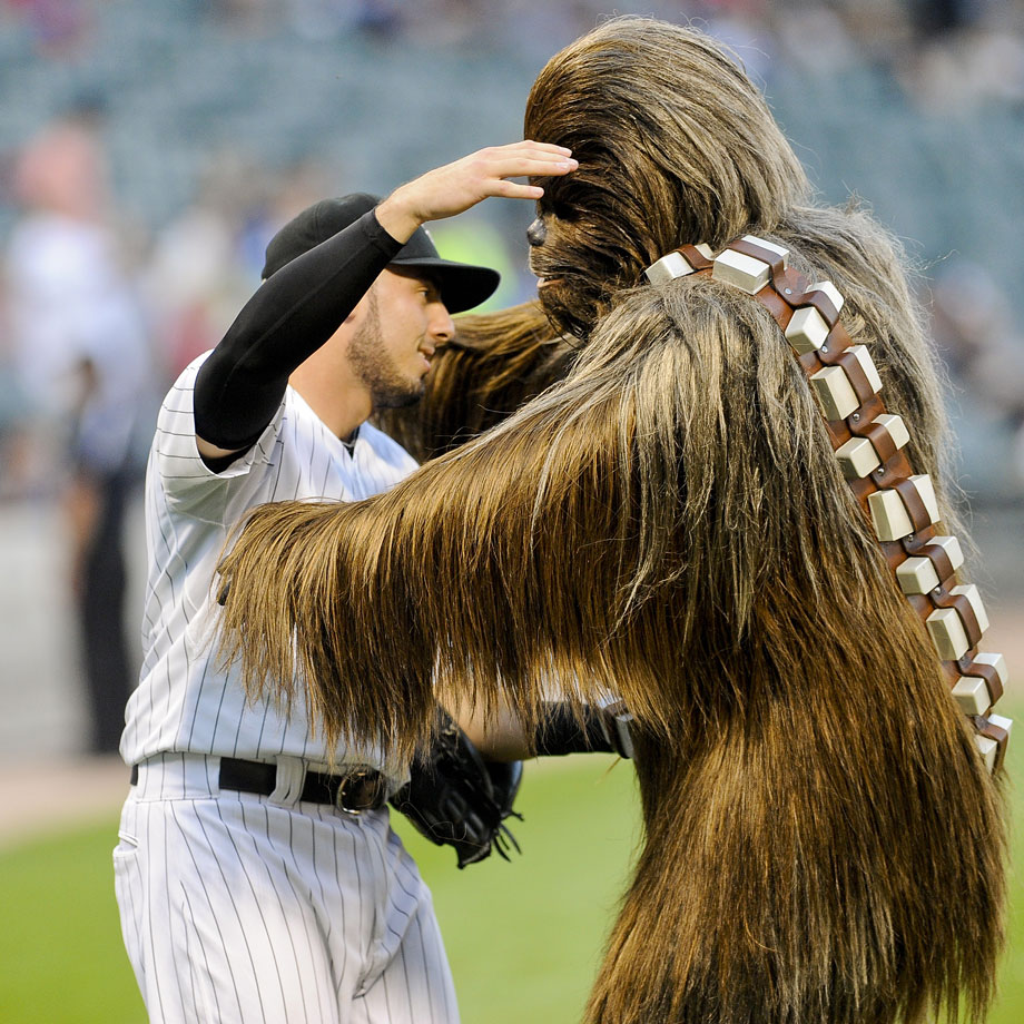 "Chewbacca hugs Chicago White Sox catcher Adrian Nieto after throwing out the ceremonial first pitch before the White Sox game against the Cleveland Indians during ""Star Wars Night' on Aug. 29, 2014 at U.S. Cellular Field in Chicago."