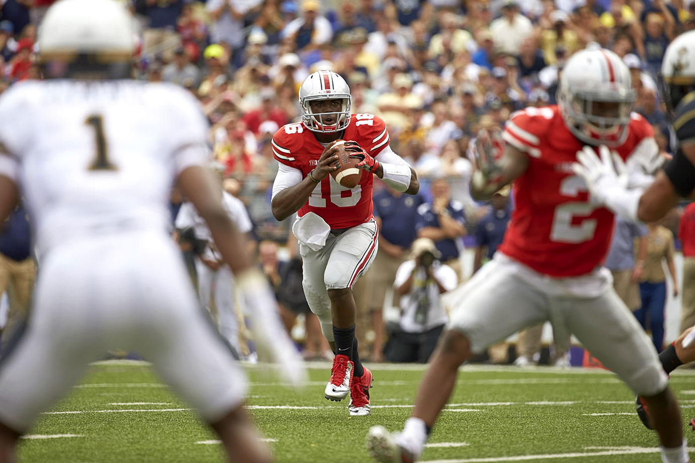 The J.T. Barrett era began with neither a bang nor a whimper, but instead a calm, conservative victory. The redshirt freshman completed 12-of-15 passes for 226 yards with two touchdowns and a blunder of an interception.