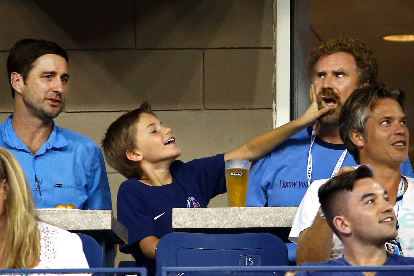 Luke Wilson, Will Ferrell and Ferrell's son Mattias watch the match between Roger Federer and Marcel Granollers on Day 7 of the US Open on Aug. 31, 2014 at the USTA Billie Jean King National Tennis Center in Flushing, N.Y.