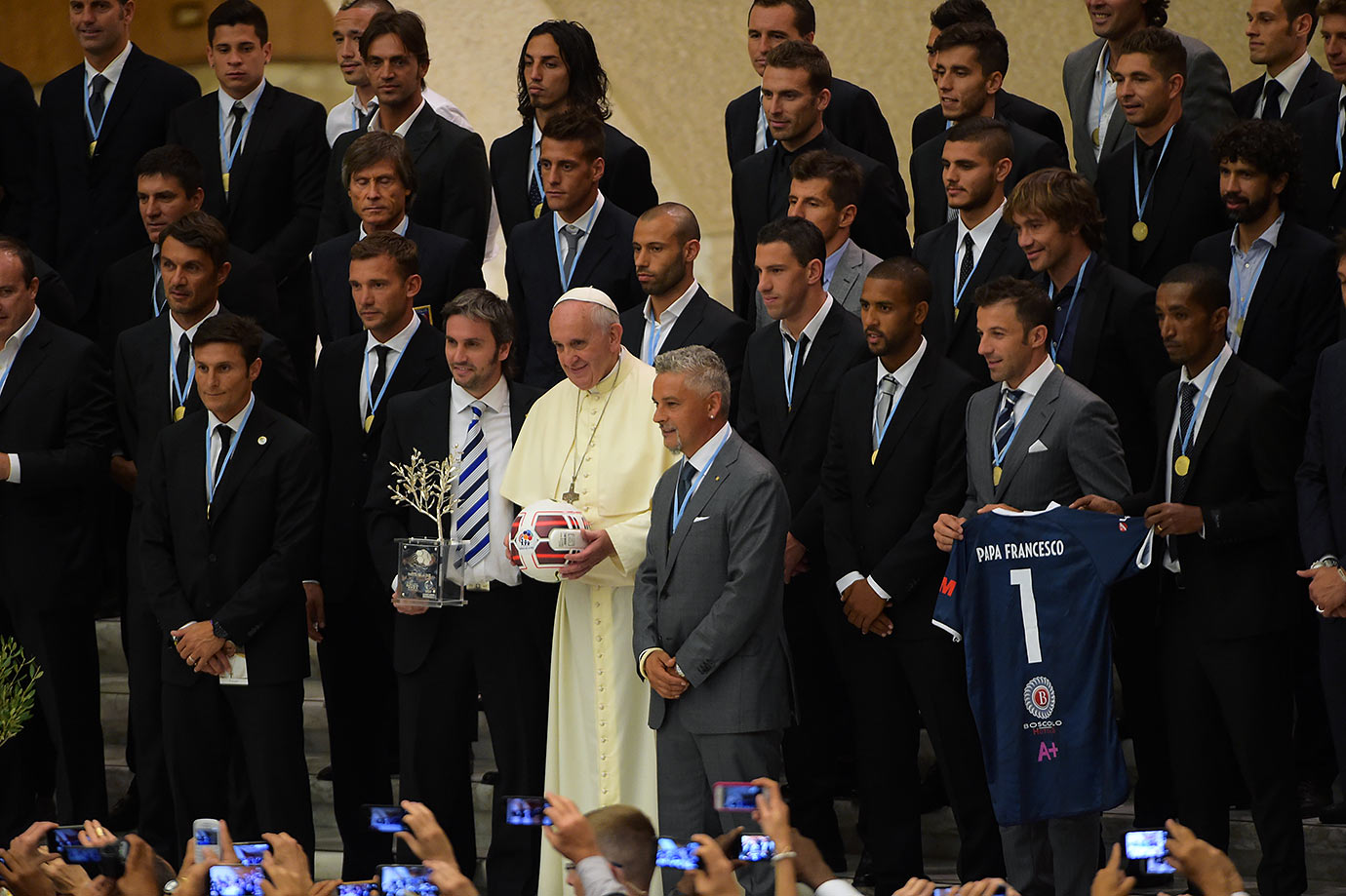 Pope Francis takes a group photo with the players of the 'Partita Interreligiosa Della Pace' at Paul VI Hall on September 1, 2014 in Vatican City.