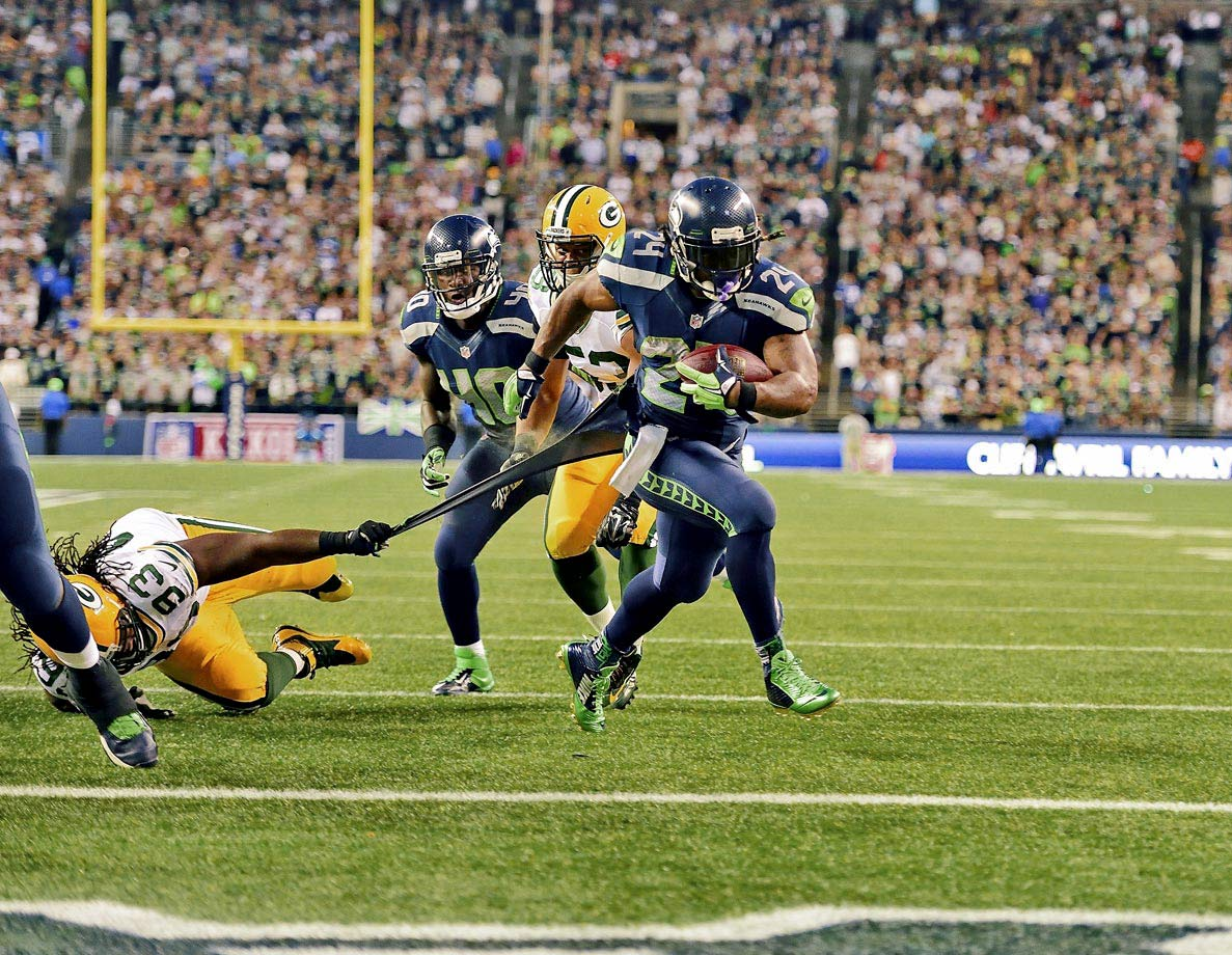 In the first game of the 2014 NFL season, Russell Wilson threw for two touchdowns and Marshawn Lynch ran for two more as the Seahawks ran over the Green Bay Packers with a 36-16 win. The Seattle defense held Aaron Rodgers to fewer than 200 yards passing.
