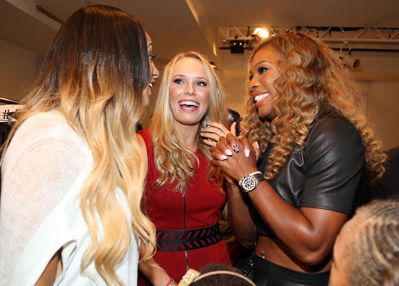 Caroline Wozniacki and Serena Williams chat with Alexis Stoudemire backstage at the Serena Williams Signature Statement by HSN fashion show during Style360 Spring 2015 at Metropolitan West on Sept. 9, 2014 in New York City.