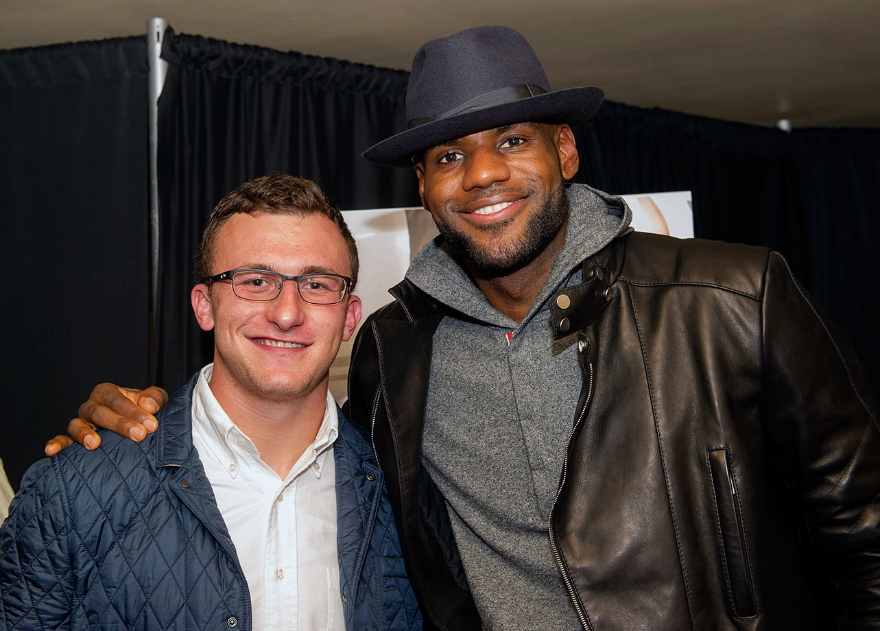 "Johnny Manziel and LeBron James pose together at the Starz screening of ""Survivor's Remorse"" on Sep. 11, 2014 at the Capitol Theater in Cleveland."