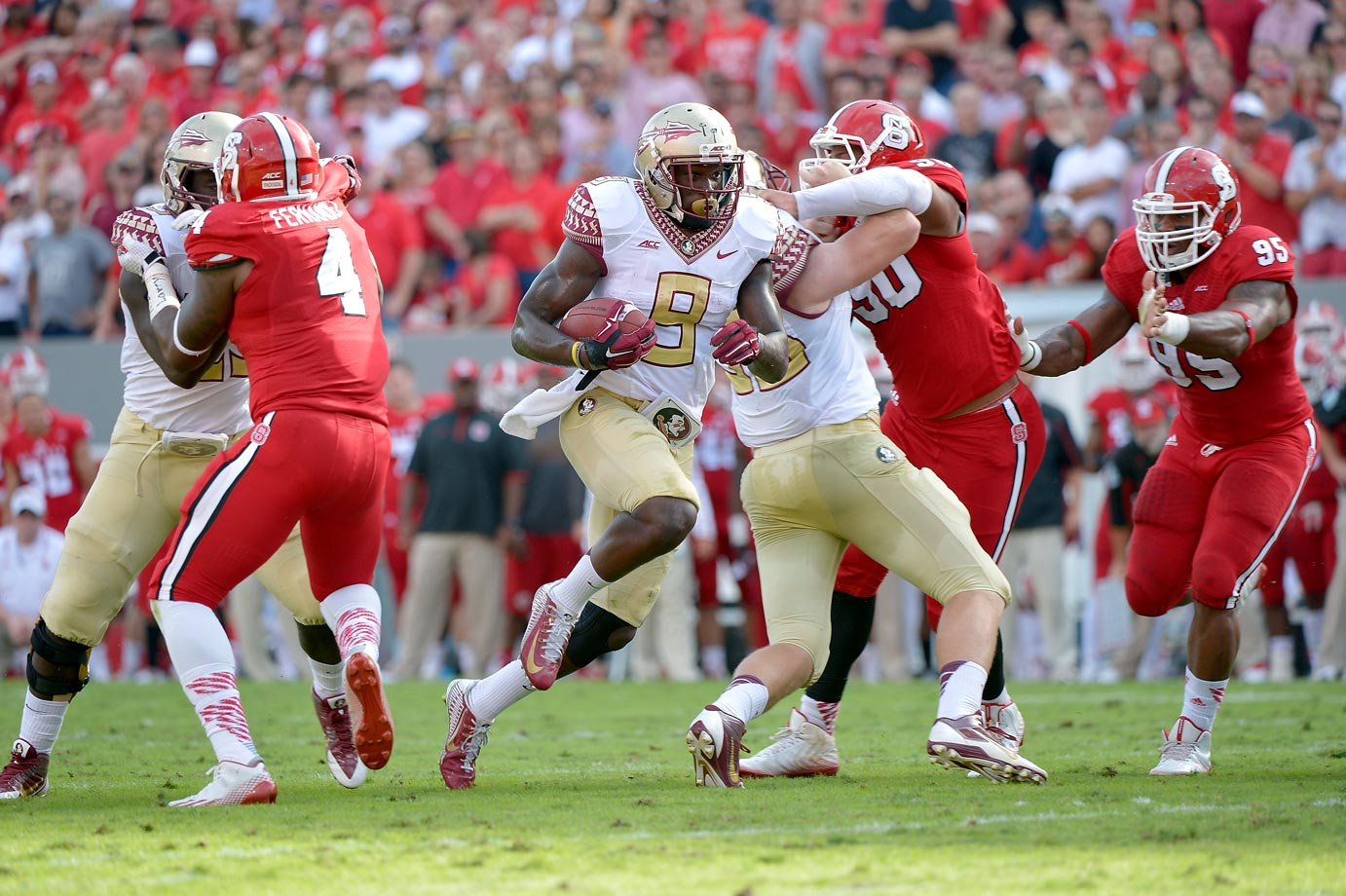 After spotting the Wolfpack a 17-point lead in the first quarter and a 38-28 advantage in the third quarter, Winston and the Seminoles offense rallied for four touchdowns in the final 20:06 to come back and pull away. Karlos Williams picked up 126 yards and three touchdowns on the ground.