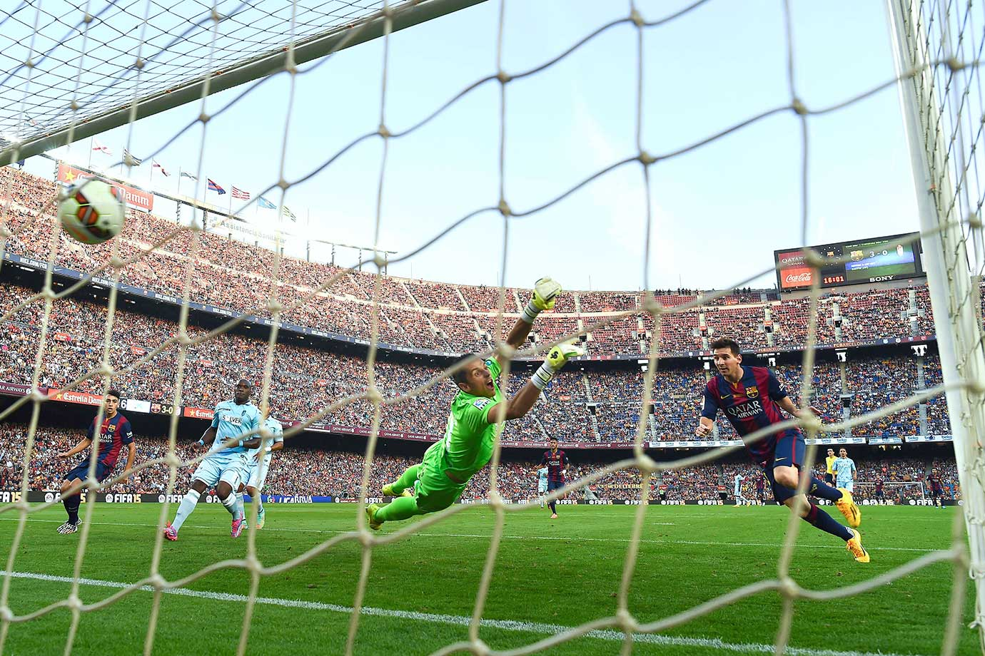 Barcelona's Lionel Messi scores his team's fourth goal during the La Liga match against Granada CF on Sept. 27, 2014 at Camp Nou stadium in Barcelona, Spain.