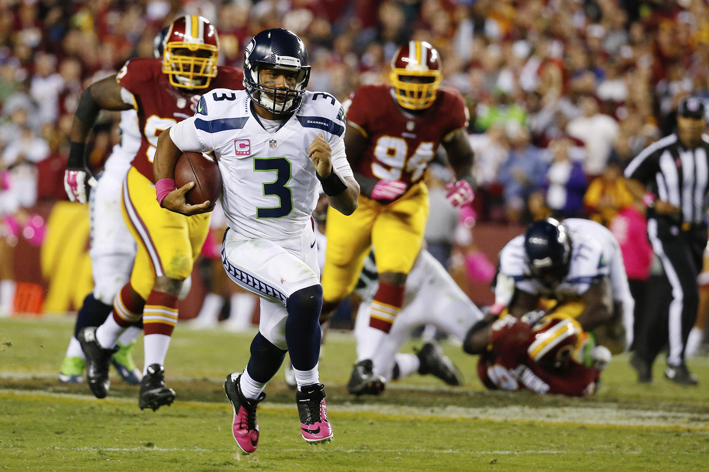 Russell Wilson owned the big stage on Monday Night Football, completing 18 of 24 passes four 201 yards and two touchdowns, and running 11 times for 122 yards and another score. The Seahawks defense shutdown Washington's rushing attack, holding Alfred Morris to a paltry 2.2 yards per carry.