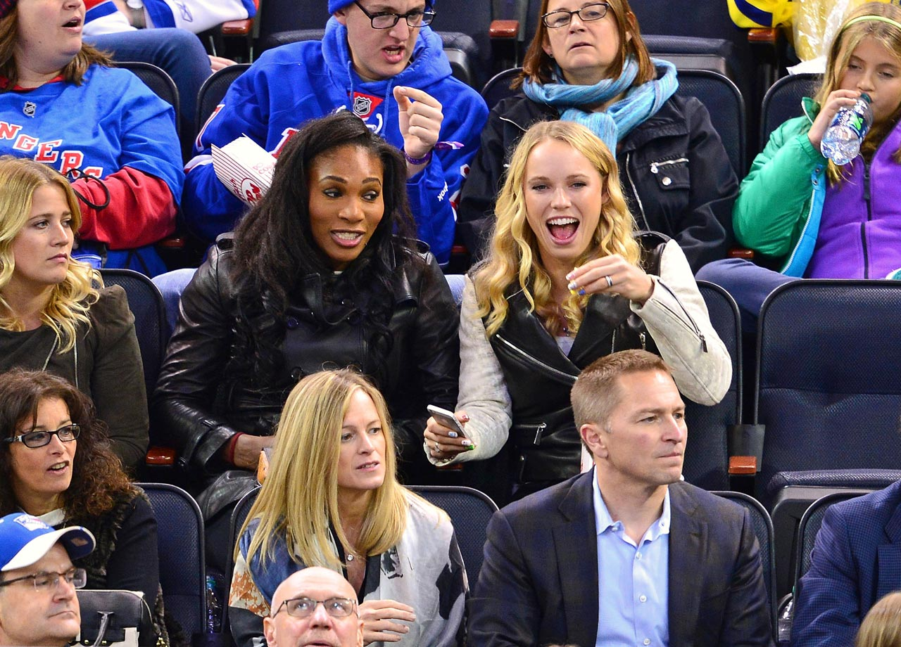 Serena Williams and Caroline Wozniacki attend the New York Rangers game against the Winnipeg Jets at Madison Square Garden on Nov. 1, 2014 in New York City.