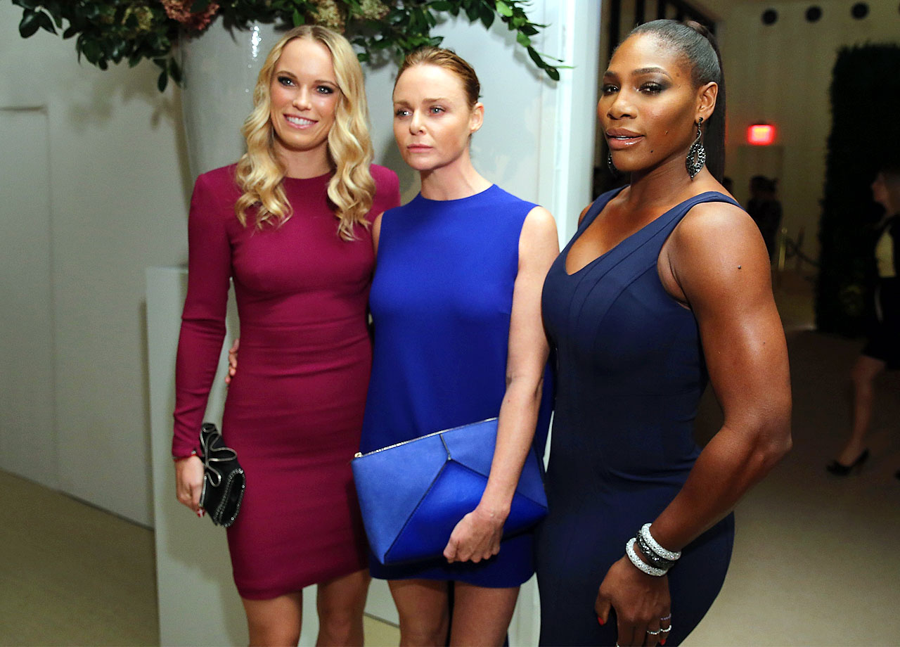 Caroline Wozniacki and Serena Williams pose with Stella McCartney during the 11th annual CFDA/Vogue Fashion Fund Awards at Spring Studios on Nov. 3, 2014 in New York City.