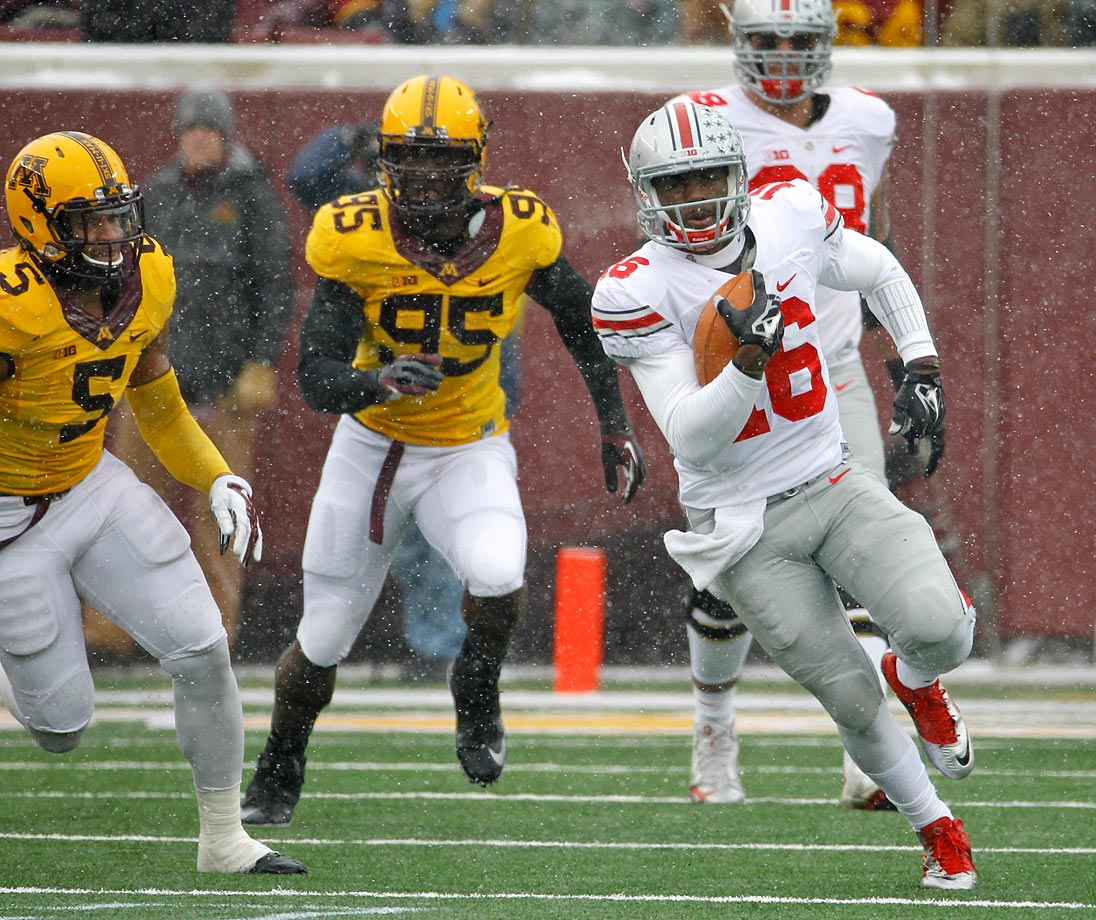 The Buckeyes picked up their second road victory over a ranked team in as many weeks, surviving heavy snow and a 145-yard, three touchdown effort from Golden Gophers running back David Cobb. Despite Barrett setting the Ohio State record for total touchdowns in a season, the Buckeyes needed a late onside kick recovery to seal the win.