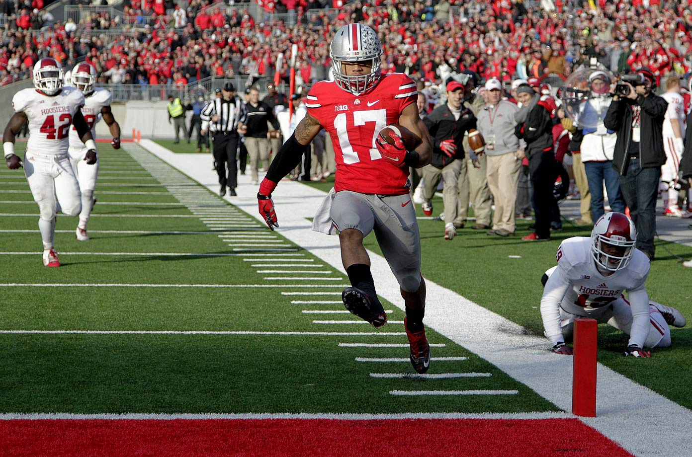 Tevin Coleman (228 yards rushing and three touchdowns) and the Hoosiers gave the Buckeyes all they could handle and might have pulled the stunning upset if not for Jalin Marshall. Ohio State's redshirt freshman score four straight second-half touchdowns, including a 54-yard punt return late in the third quarter that gave the Buckeyes the lead for good.
