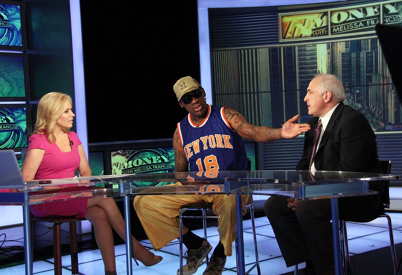Rodman dressed a tad more appropriately while appearing on The Fox Business Network alongside Melissa Francis and Brandon Steiner in 2014.