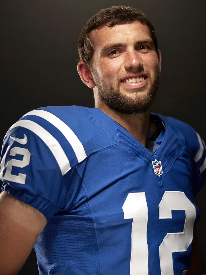 Andrew Luck smiles during his SI cover photo shoot on Aug. 26, 2014 at Indiana Farm Bureau Football Center in Indianapolis.