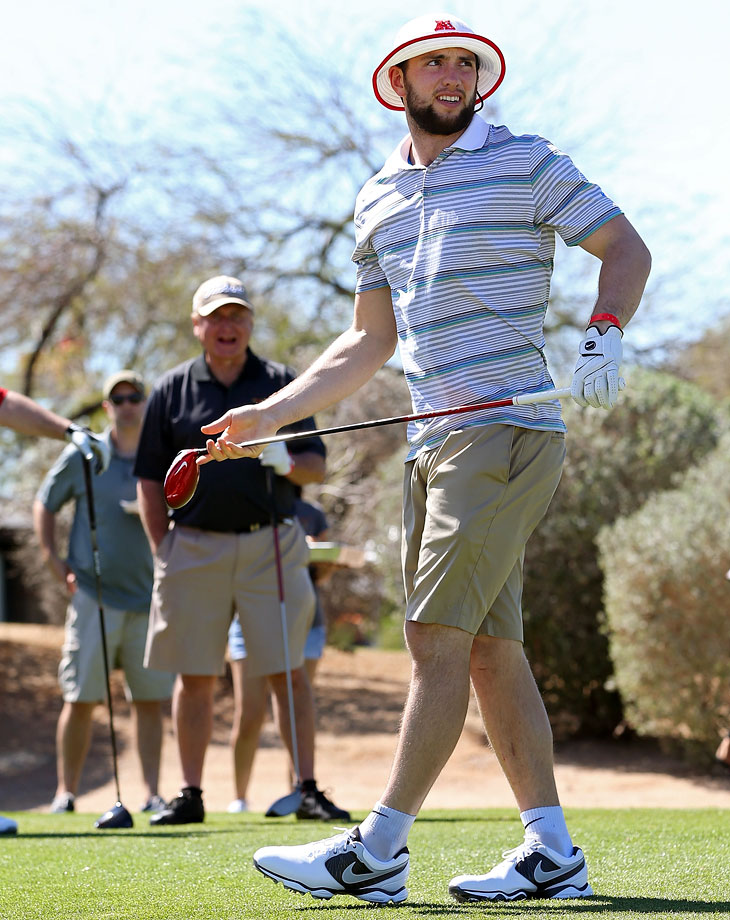 Andrew Luck watches his drive during the Arizona Celebrity Golf Classic benefitting the Arians Family Foundation on March 8, 2014 at the Westin Kierland Resort & Spa in Scottsdale, Ariz.
