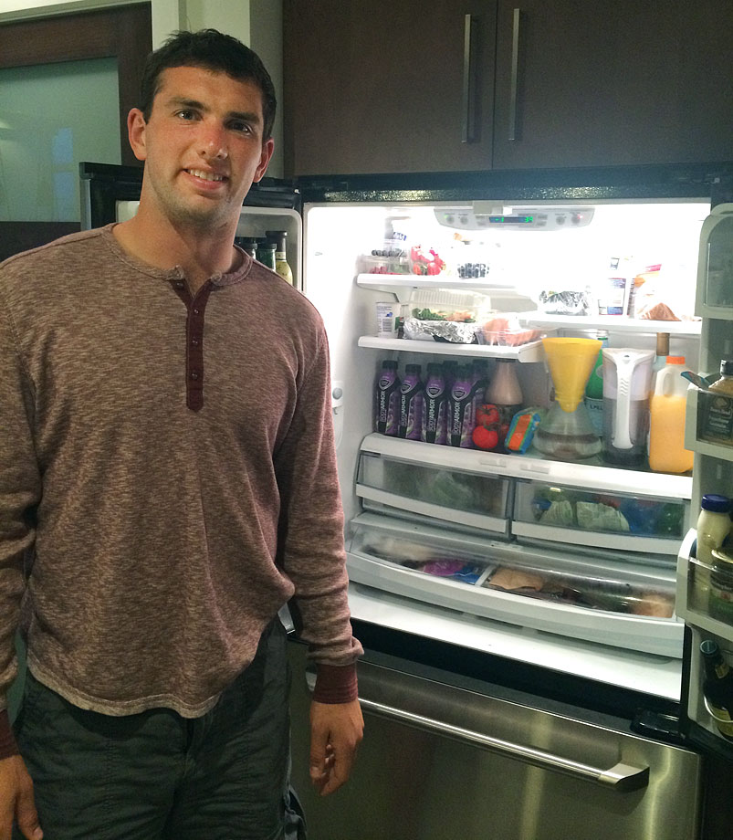 Andrew Luck stands in front of his refrigerator in 2014.