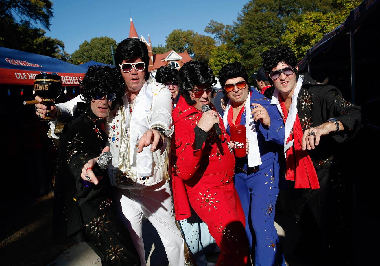 Fans dressed as Elvis attend parties in The Grove prior to a game between the Ole' Miss and Auburn at Vaught-Hemingway Stadium in Oxford, Miss., Nov. 1, 2014.