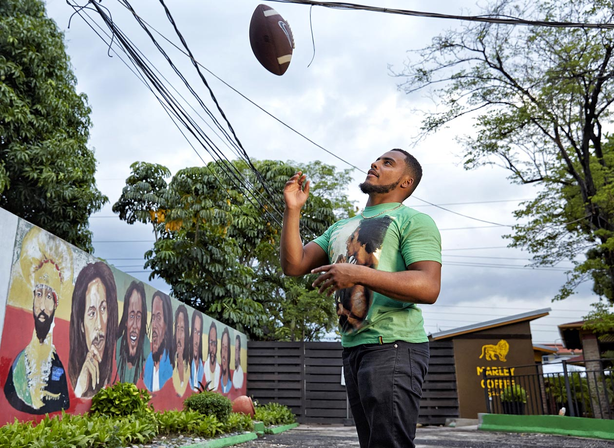Tulane linebacker Nico Marley, grandson of Bob Marley, tosses a football during an SI photo shoot at the Bob Marley Museum in Kingston, Jamaica, on May 16, 2014.