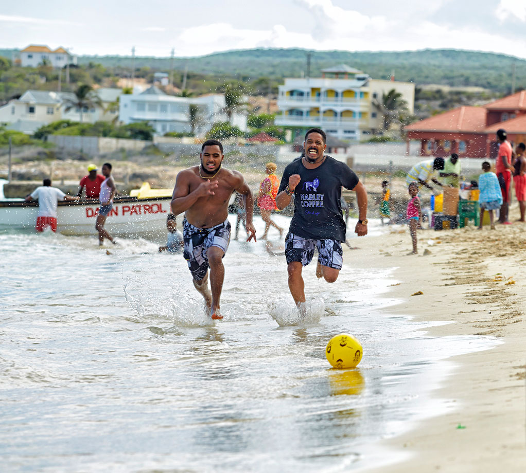 Nico Marley races his dad Rohan Marley along Hellshire Beach in Jamaica on May 16, 2014.