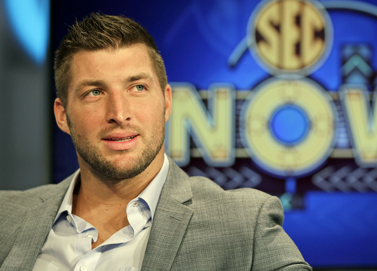Tim Tebow ponders a question during an interview on the set of ESPN's new SEC Network in Charlotte, N.C. Tebow had a new job as a commentator for the SEC Network, but was still looking for work in the NFL as a quarterback.