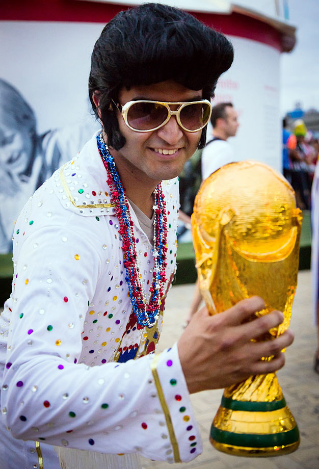 An Elvis fan poses with a World Cup trophy before the Group G match between Ghana and USA at Estadio das Dunas in Brazil on June 16, 2014.