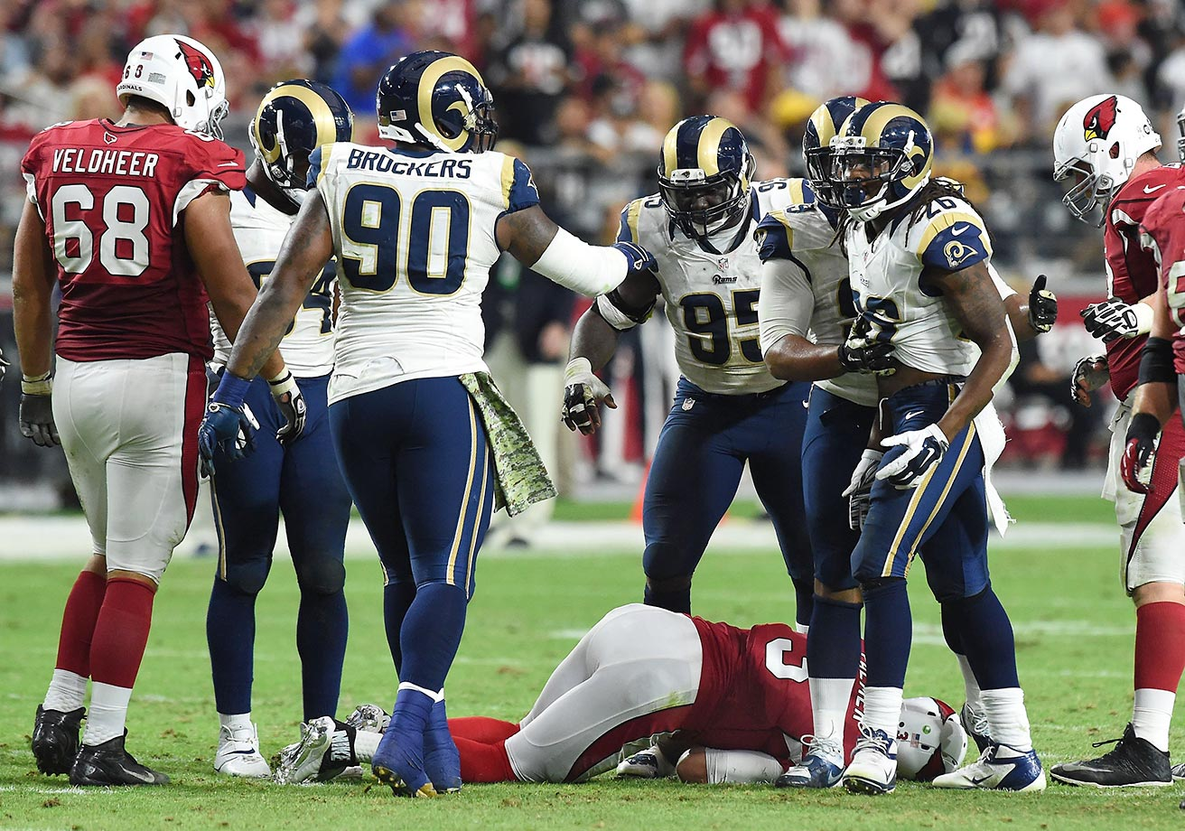 "Two days after he agreed to a three-year, $50 million contract extension ($20.5 million guaranteed), Palmer suffered another torn left ACL injury, this time while trying to avoid a blitzing St. Louis Ram safety. There was no contact when Palmer was hurt. He had stepped up to avoid blitzing safety Mark Barron.""I've done that move thousands of times,"" Palmer said. ""... My foot hit the grass and the grass gave way. It was just a freak thing."""