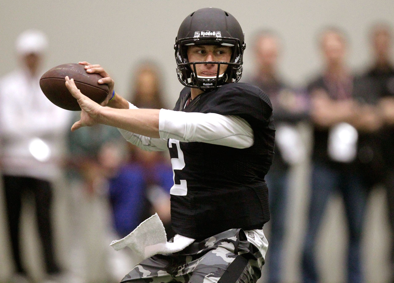 "It was a pro day like we've never seen before on March 27, 2014. Music from Drake filled Texas A&M's indoor facility as ""Johnny Football,"" who has always scrambled to the beat of his own orchestra, did something no other draft-eligible quarterback had ever done. He went through his group workout for NFL executives, coaches and scouts wearing helmet and shoulder pads."