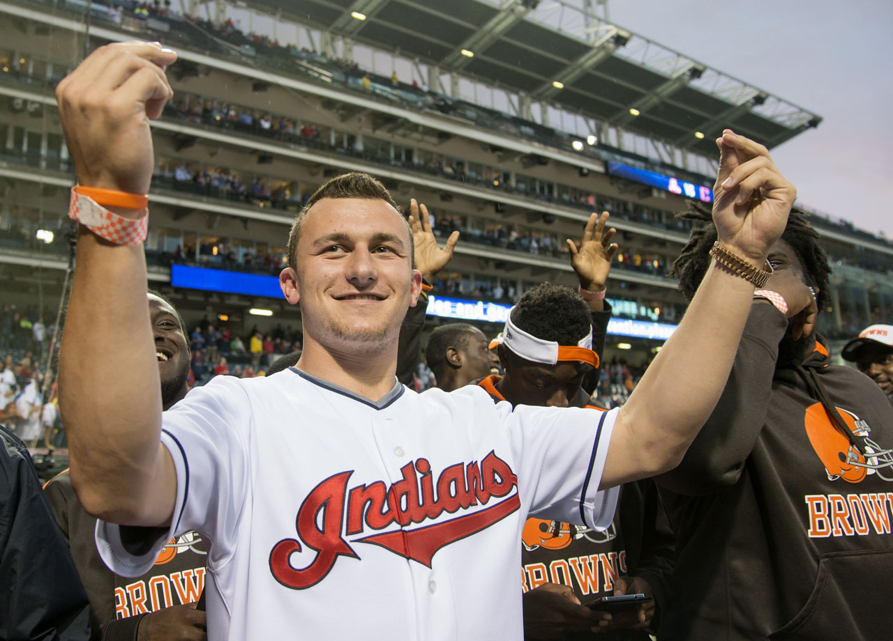 Johnny Manziel acknowledges the crowd of Cleveland Indians fans, along with other Browns rookies, prior to the game against the Boston Red Sox on June 4, 2014 at Progressive Field in Cleveland.