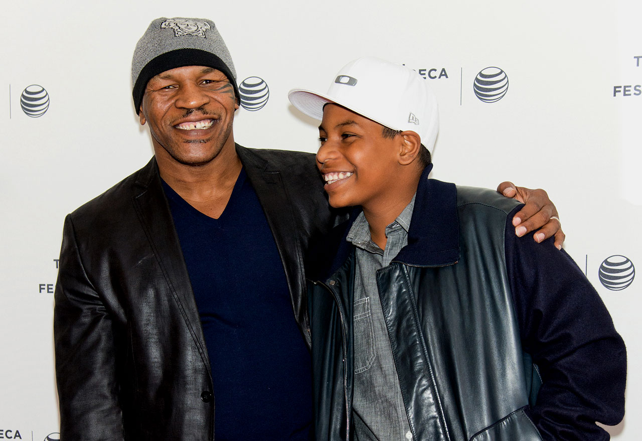 "Mike Tyson and his son Miguel attend Tribeca Talks: After the Movie: ""Champs"" during the 2014 Tribeca Film Festival at SVA Theater in New York City."