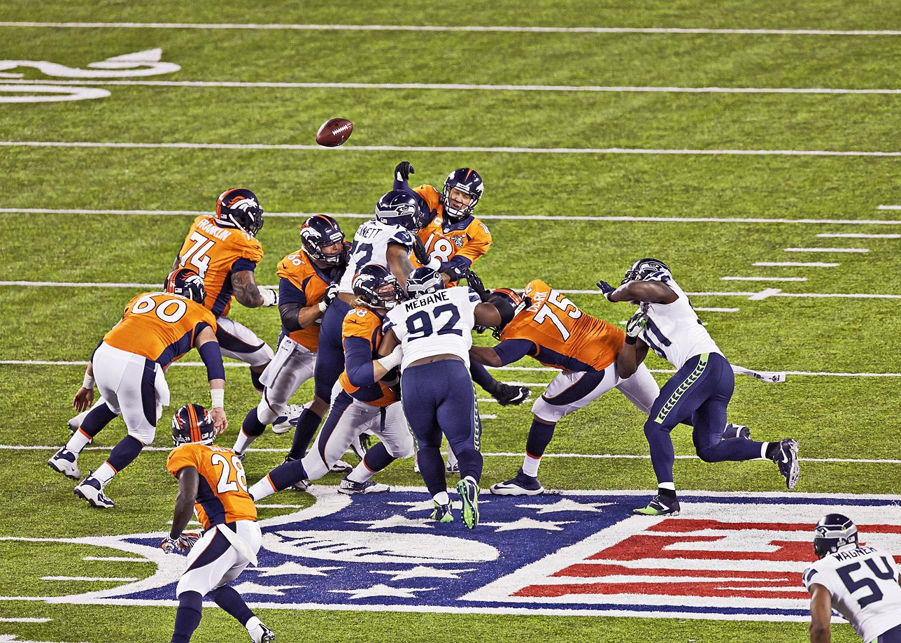 Michael Bennett forces a fumble by Peyton Manning in Seattle's lopsided victory over the Denver Broncos.