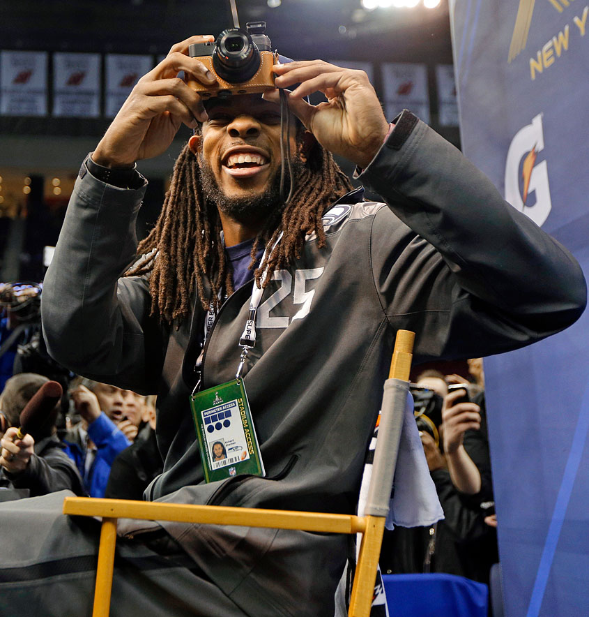 Seahawks cornerback Richard Sherman takes a picture during Media Day for Super Bowl XLVIII at the Prudential Center in Newark, N.J.
