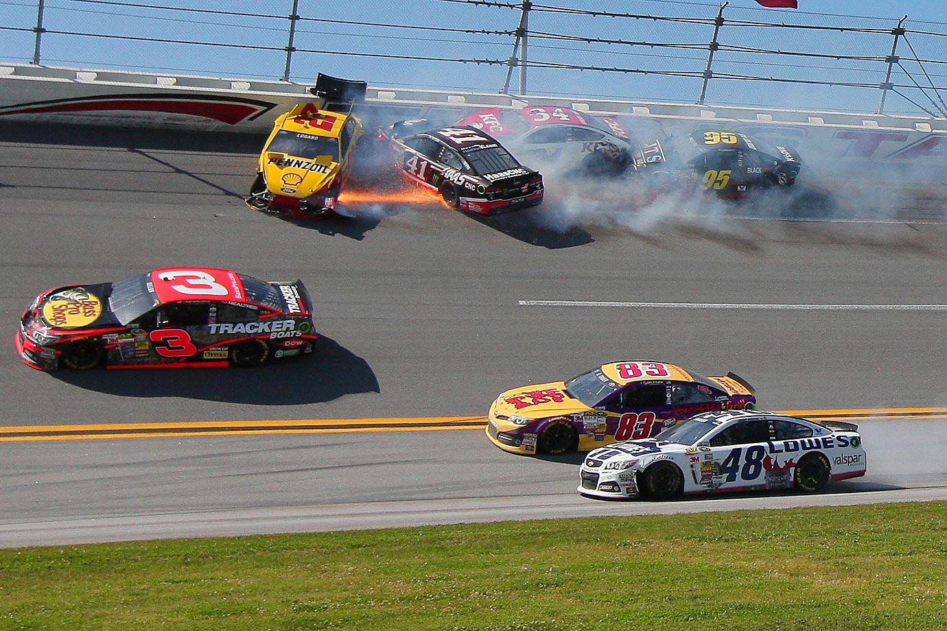 On lap 137, Brad Keselowski, who was six laps down, got loose in turn 4 and caused a multi-car wreck that collected 13 other cars that included Jeff Gordon, Matt Kenseth, Trevor Bayne, Tony Stewart and Brian Scott. Some had issues with Keselowski racing at the front with being so many laps behind the leaders. & With 14 laps to go, Jimmie Johnson got loose and started another multi-car wreck that happened in the same place that the lap 137 wreck occurred. This wreck collected Kurt Busch, Joey Logano, Michael McDowell, Ryan Newman, David Ragan, Ricky Stenhouse, Jr. and Reed Sorenson.