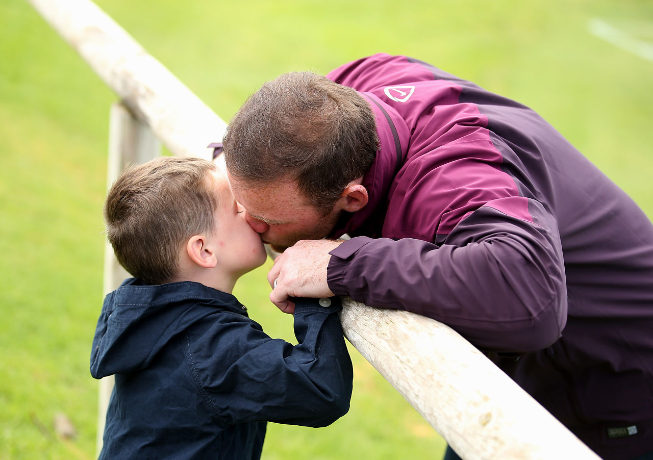 Wayne kisses his son Kai before a training session at the England pre-World Cup Training Camp at the Vale Do Lobo Resort on May 21, 2014 in Vale Do Lobo, Algarve, Portugal.