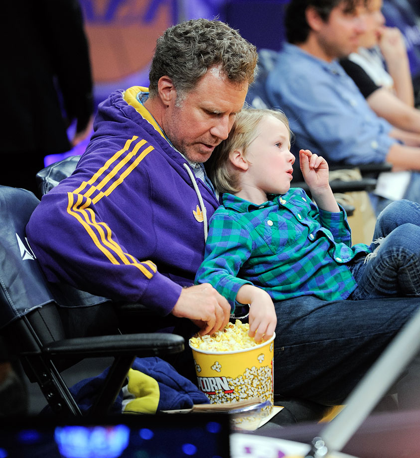 Will Ferrell and his son Axel eat popcorn during the Los Angeles Lakers game against the Brooklyn Nets on Feb. 23, 2014 at Staples Center in Los Angeles.