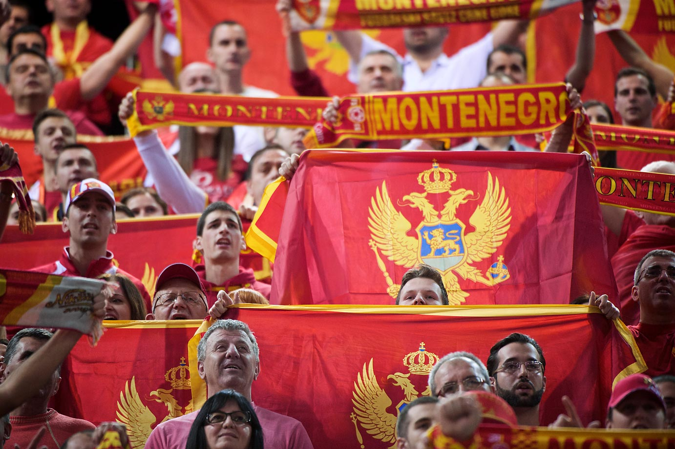 Fans cheer the Montenegro team.