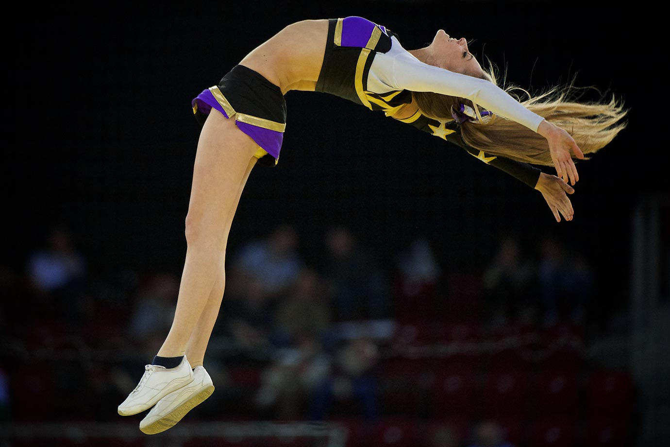 A cheerleader flies through the air during a break in the game action at the Women's Handball EURO 2014 championship.