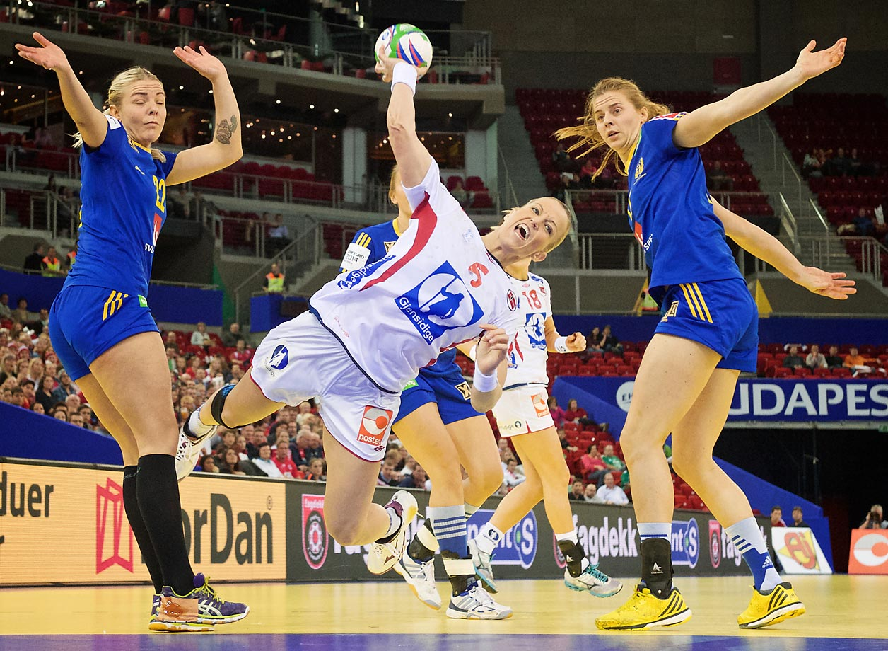 Norway's Heidi Loke scores during a semi-final game against Sweden at the Women's Handball EURO 2014 championship at the Papp Laszlo Sportarena in Budapest, Hungary.