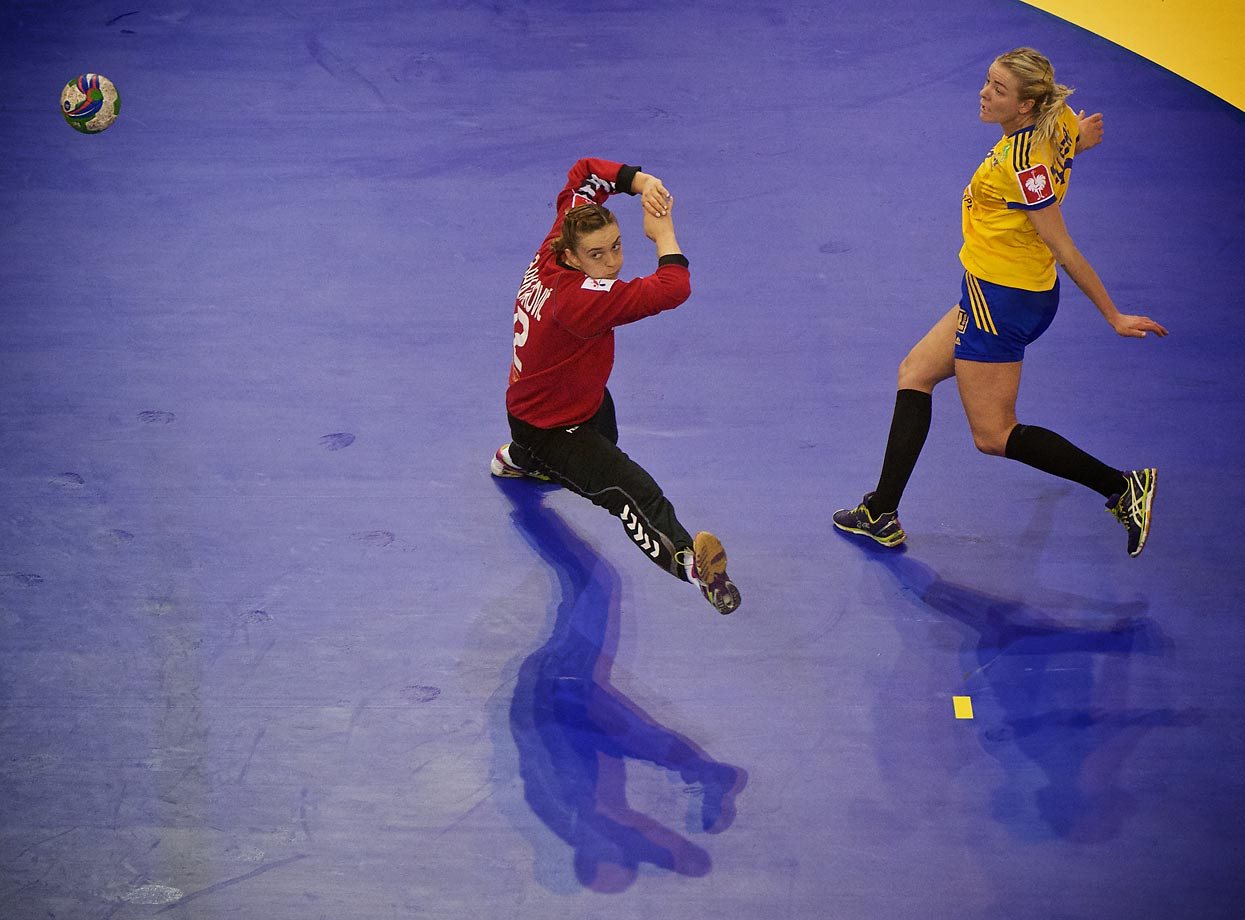 Sweden's Jessica Helleberg scores past Montenegro goalkeeper during the third place match.