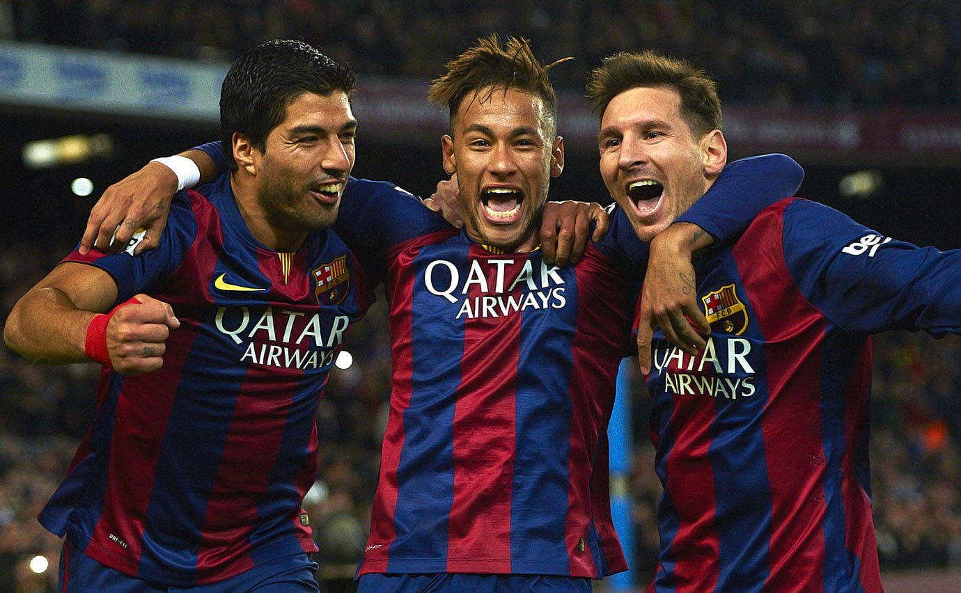 Neymar celebrates with Barcelona teammates Luis Suarez and Lionel Messi after scoring against Atletico Madrid during their La Liga match on Jan. 11, 2015 at Camp Nou in Barcelona, Spain.